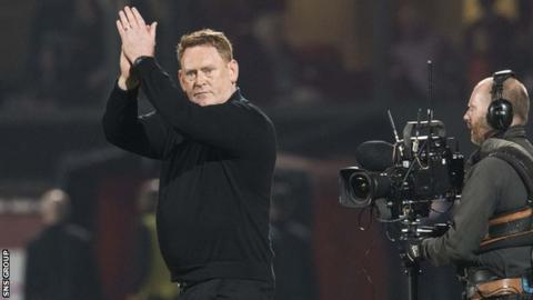 Livingston manager David Hopkin applauds the fans during the play-off semi-final against Dundee United