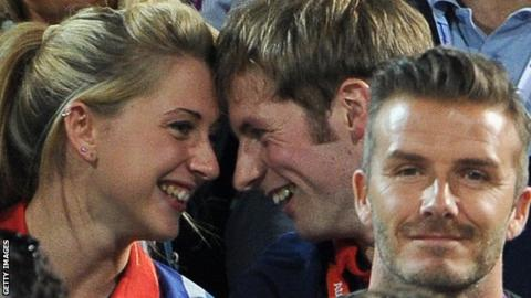 Laura Trott, Jason Kenny and David Beckham watching the beach volleyball during the London 2012 Olympics