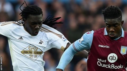 Bafetimbi Gomis (left) with Micah Richards