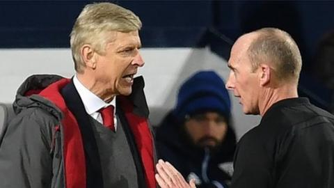 Arsene Wenger and Mike Dean