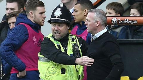Ipswich Town boss Paul Lambert (right) is restrained by a policeman