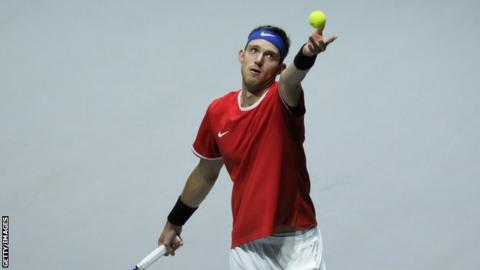 Chilean tennis player Nicolas Jarry serves during a Davis Cup match