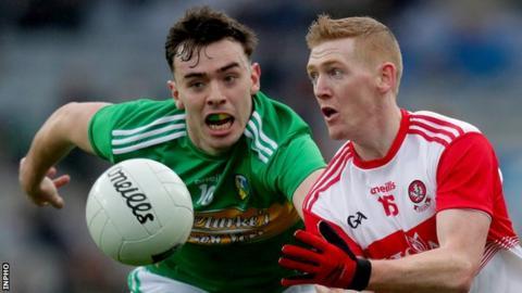 Derry's Christopher Bradley battles with Leitrim's Dean McGovern