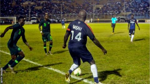 George Weah in action for Liberia at the age of 51