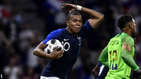 Kylian Mbappe celebrates scoring France's equaliser against the USA