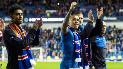 Rangers players celebrate winning promotion