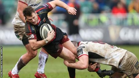 Josh Lewis of Dragons is tackled by Nick Timoney of Ulster