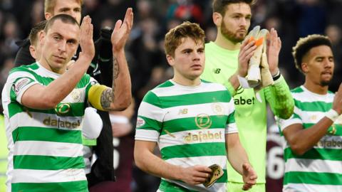 Celtic players applaud the travelling fans after losing 4-0 at Hearts