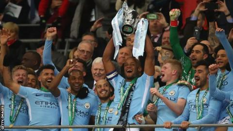 Manchester City captain Vincent Kompany lifts the Carabao Cup in 2018