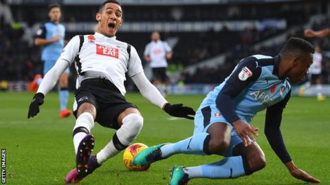 Derby's Tom Ince is fouled by Rotherham defender Darnell Fisher