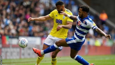 Birmingham striker Isaac Vassell was up against Reading's Liam Moore at the Madejski Stadium