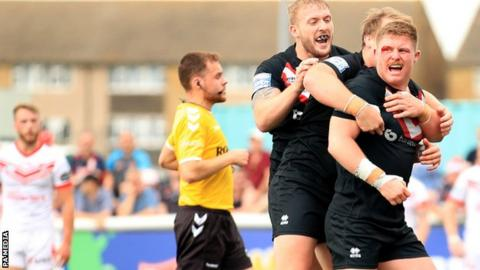 London Broncos celebrate a try against St Helens