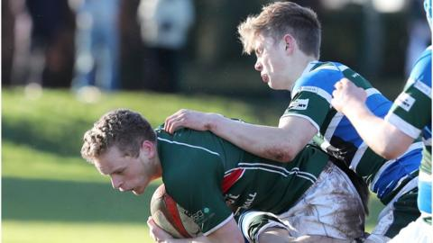 Curtis Dundas of Friends is tackled by Jack Kennedy of Grosvenor - Friends won 30-0 and will host Belfast Royal Academy in the last eight