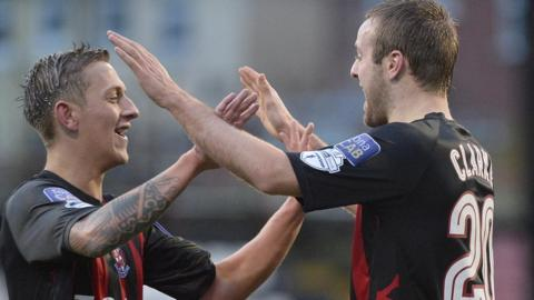 Matthew Snoddy and Richard Clarke of Crusaders celebrate a goal during their 3-2 home win over Ballymena