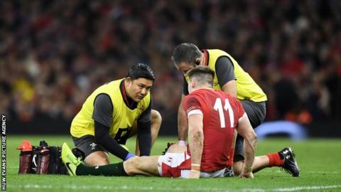 Josh Adams receives treatment against France