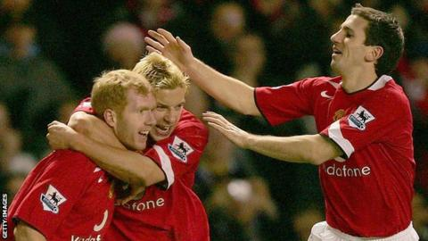 Liam Miller (right) and Alan Smith (centre) congratulate Paul Scholes after a Manchester United goal in 2004