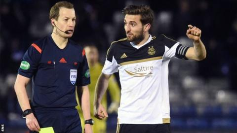 Willie Collum is questioned by Aberdeen defender Graeme Shinnie