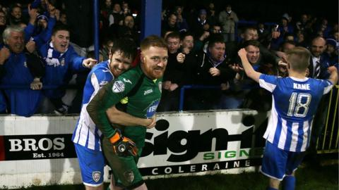 Coleraine players celebrate with supporters after beating Ballinamallard in a penalty shoot-out after their Irish Cup match ended 2-2