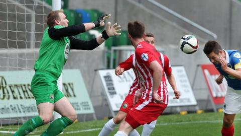 Warrenpoint keeper Aaron Shanahan fails to keep out this header from Linfield striker Andrew Waterworth at Windsor Park