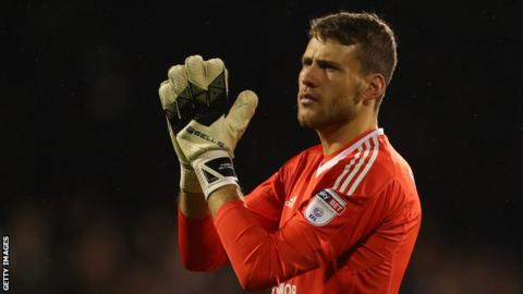 Marcus Bettinelli in action for Fulham