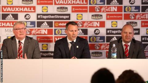 Former FAW President Dai Griffiths, Wales manager Ryan Giggs and FAW chief executive Jonathan Ford