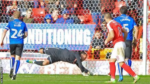 Josh Lillis saves Johnnie Jackson's penalty