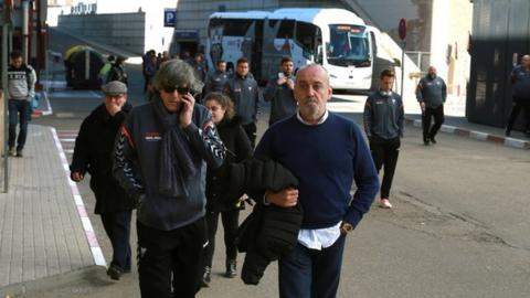 Albacete boss Enrique Martin (left, front) is pictured arriving at the hospital where Pelayo Novo is being treated