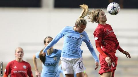 Claire Emslie and Lina Hurtig of Swedish side Linkoping jump for the ball during the Women's Champions League quarter final, which City won 7-3 on aggregate