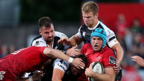 Tadhg Beirne gains ground for Munster despite the efforts of Ospreys duo Tom Botha and Olly Cracknell