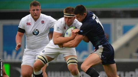 Max Green of England is tackled by Scotland's Blair Kinghorn