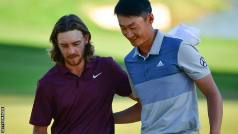 China's Li Haotong, right, with playing partner Tommy Fleetwood