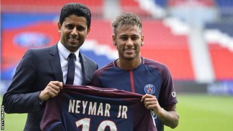Neymar pictured with Paris St-Germain president Nasser Al-Khelaifi after completing his 220m euro move