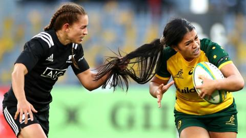 Perth, Australia, 10 August: Selina Winiata, of New Zealand's Black Ferns, pulls the hair of Alysia Lefau-Fakaosilea, of Australia's Wallaroos, during the women's Test at Optus Stadium. (Photo by Cameron Spencer/Getty Images)
