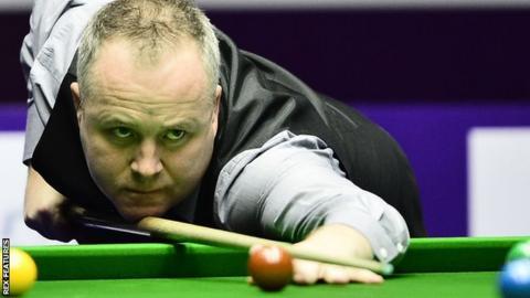 John Higgins plays a shot at the International Championship in China
