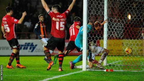 Paul Benson bundles home Luton Town's 100th-minute winner