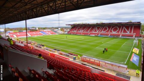 Richie Wellens' Swindon Town side are 11th in League Two, six points off the play-off places