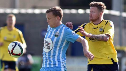 Warrenpoint Town's Liam Bagnall and Matt Hazley of Dungannon Swifts try to gain possession at Milltown