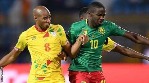 Benin's Jordan Adeoti challenges Cameroon's Arnaud Djoum