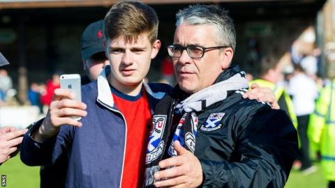 A fan takes a selfie with Ayr United manager Ian McCall