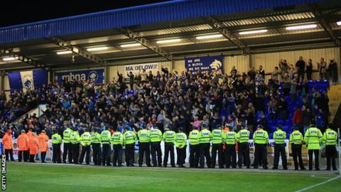 Police in front of the fans in a match between Chester and Wrexham in September 2014