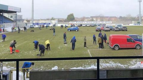 Glenavon issued a plea for volunteers to help clear snow from the pitch at Mourneview Park