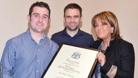 Louise Dunlop with her sons Michael and William (centre)