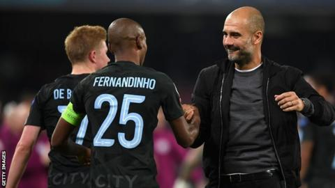 Pep Guardiola celebrates with Fernandinho and Kevin de Bruyne