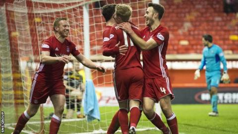 Aberdeen remain eight points behind Celtic after a win over Partick Thistle