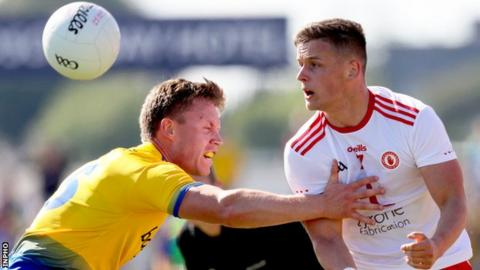 Roscommon's Niall Daly with Michael McKernan of Tyrone