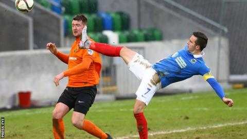 Gareth McKeown (left) in action for Carrick Rangers against Linfield on 30 January