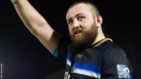 Bath hooker Tom Dunn waves to the home fans after a game against Toulon in November 2017