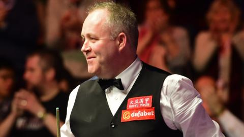 John Higgins gets a rousing reception after completing his 5-0 victory