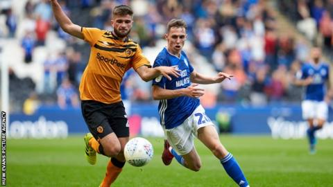 Hull's Brandon Fleming is chased down by Cardiff's Gavin Whyte
