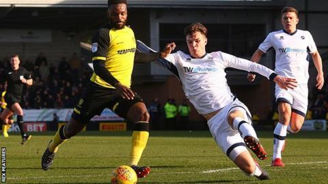 Burton's Darren Bent has a strike at goal against Millwall
